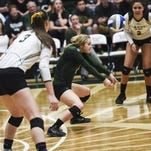 CSU volleyball's Jaime Colaizzi, wearing green to signify her libero position, makes a hit in a match against CU in the NCAA tournament last December.