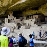 Groups tour through Cliff Palace, one of the larger cliff dwellings in the park at Mesa Verde National Park.