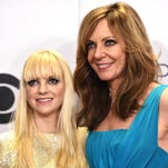 Co-hosts Anna Faris, left, and Allison Janney pose in the press room at the People's Choice Awards at the Nokia Theatre on Wednesday, Jan. 7, 2015, in Los Angeles. (Photo by Jordan Strauss/Invision/AP)