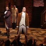 "Leslie Odom, Jr. (L)  and Lin-Manuel Miranda (R) and cast of ""Hamilton"" perform on stage during ""Hamilton"" GRAMMY performance."