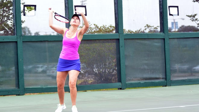 Brenda Hegwood plays a women's doubles tennis match at the Willis Terry Tennis Complex at Tatum Park.