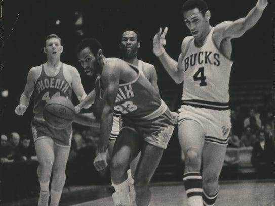 Phoenix Suns' Bob Warlick dribbles in for a shot, but