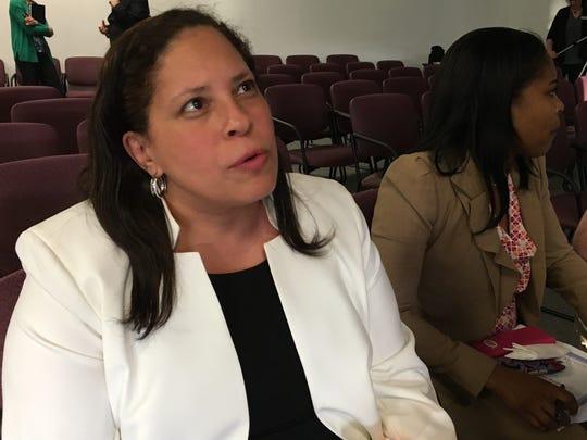 Dea Moore-Young at a Muncie School Board meeting.