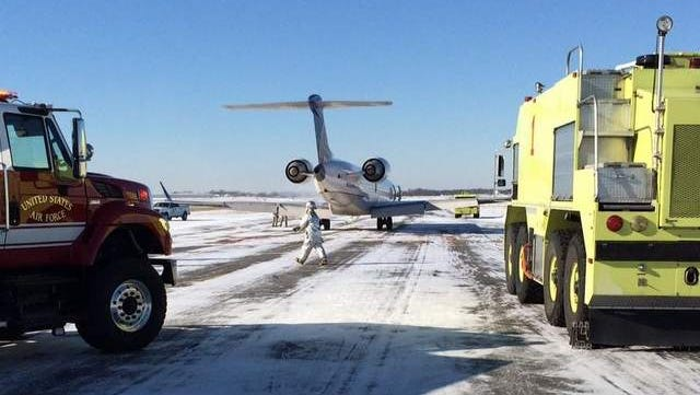 A United Express regional jet at the New Castle Airport Wednesday morning after an emergency landing. / WILLIAM H. MCMICHAEL/THE NEWS JOURNAL