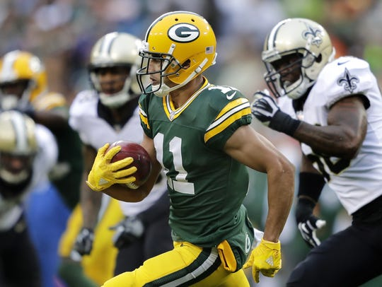 Green Bay Packers receiver Trevor Davis (11) returns a kick against the New Orleans Saints on Sunday, Oct. 22, 2017, at Lambeau Field