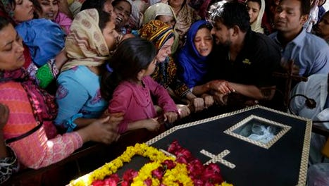 Pakistani Christian women mourn the death of Sharmoon who was killed in a bombing attack, in Lahore, Pakistan, Monday, March 28, 2016. The death toll from a massive suicide bombing targeting Christians gathered on Easter in the eastern Pakistani city of Lahore rose on Monday as the country started observing a three-day mourning period following the attack. (AP Photo/K.M. Chaudary)