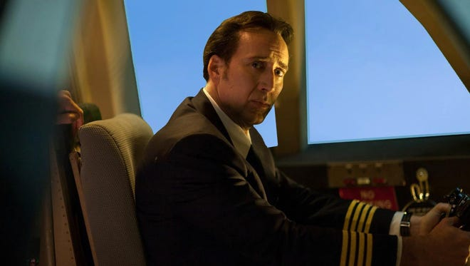 """Nicolas Cage stars as a pilot steering a fateful plane in the film """"Left Behind."""""""