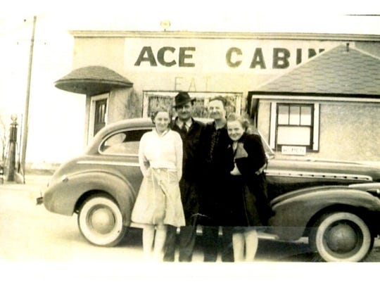 Betty and Clarence Kowitz stand in front of the Ace Bar in St. Cloud with friends. The car is a 1940 Chevy and the photo was taken in the early 1940s.