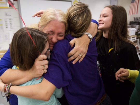 Joy Williams, an art teacher at Cypress Middle School is congratulated by her students after finding out she is one of 30 finalists for the Golden Apple.