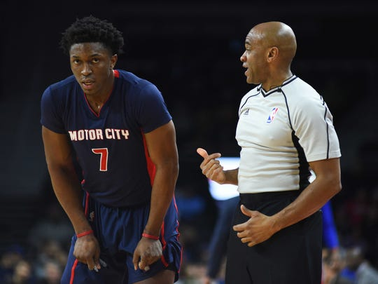 Pistons forward Stanley Johnson (7) talks to referee Tre Maddox (73) during the third quarter of the Pistons' 97-79 loss Sunday at the Palace.