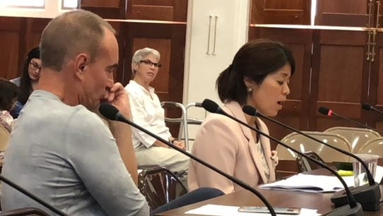 Dr. Kozue Shimubukuro, right, reads her written statement alleging mismanagement, corruption and politicking at Guam Memorial Hospital, while Dr. Jerone Landstrom, left, looks on, during Monday's public hearing on a bill seeking to repeal a 2 percent sales tax law before it takes into effect on Oct. 1. The sales tax would have given GMH about $30 million a year in dedicated funding source to address its perennial operational shortfall.