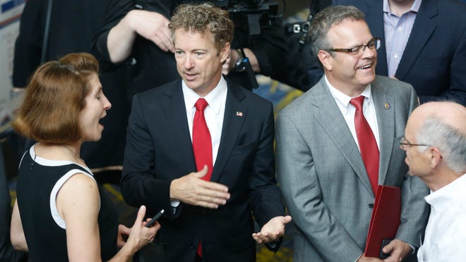 Republican Rand Paul talks with guests Saturday before the Republican Party of Iowa's Lincoln Dinner in Des Moines.