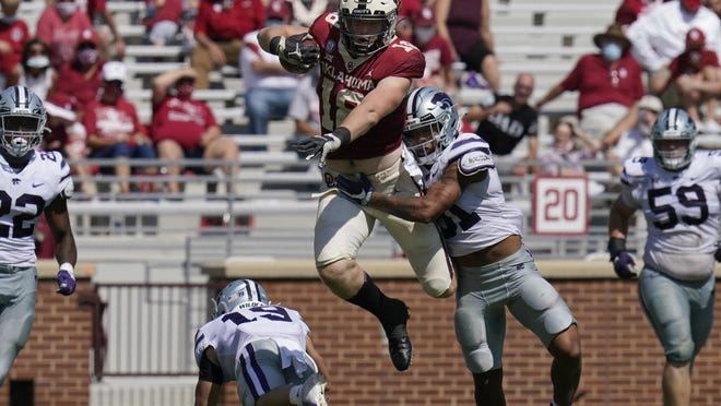 Kansas State defensive back Jahron McPherson wraps up Oklahoma running back Austin Stogner in the second half of the Wildcats' upset of the Sooners in Norman, Okla. McPherson was honored Monday as the Big 12's co-defensive player of the week.
