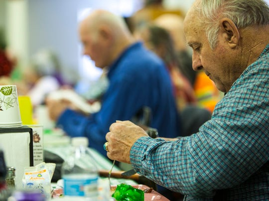 People eat lunch at the Cedar City senior citizen center,