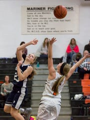 Marysville sophomore Hannah Delor takes a shot during a basketball game Tuesday, Feb. 2, 2016 at Marine City High School.