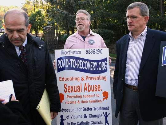"""In 2011, Attorney Mitchell Garabedian, Kevin Waldrip of Woodridge, and Father Robert Hoatson of """"Road to Recovery, pictured as advocates for victims of priest abuse."""