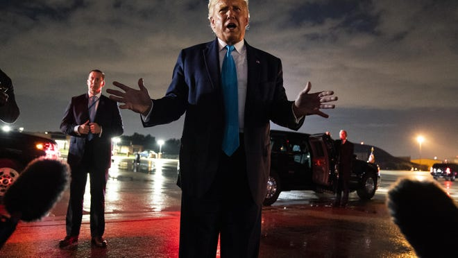 President Donald Trump talks with reporters at Andrews Air Force Base in Maryland after attending a campaign rally in Latrobe on Thursday.