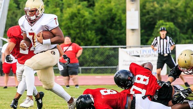 Riverdale quarterback Christian Souffront eludes Stewarts Creek tacklers.