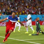 The United States? Clint Dempsey reacts after scoring his team?s first goal past goalkeeper Ghana?s Adam Kwarasey on Monday at Estadio das Dunas in Natal, Brazil. Getty Images NATAL, BRAZIL - JUNE 16: Clint Dempsey of the United States reacts after scoring his team's first goal past goalkeeper Adam Kwarasey of Ghana during the 2014 FIFA World Cup Brazil Group G match between Ghana and the United States at Estadio das Dunas on June 16, 2014 in Natal, Brazil. (Photo by Michael Steele/Getty Images)