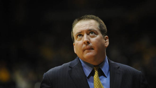 Southern Miss head coach Donnie Tyndall looks to the score board as they take on BYU.