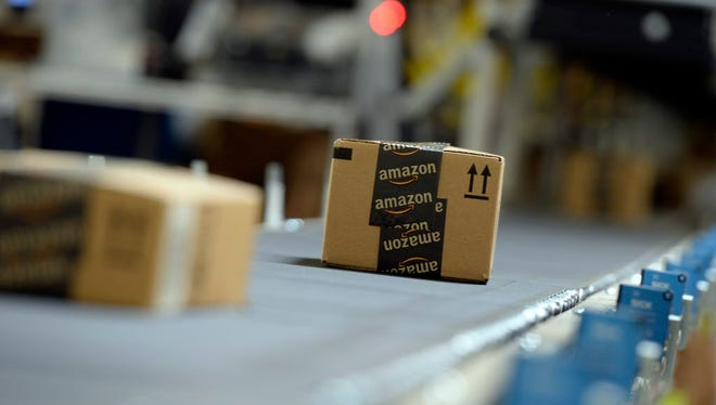 Shipping orders go by on a conveyor belt at Amazon's San Bernardino Fulfillment Center on Oct. 29, 2013 in San Bernardino, California.