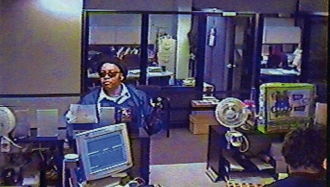 Xerox Federal Credit Union is robbed Aug. 12, 2003.