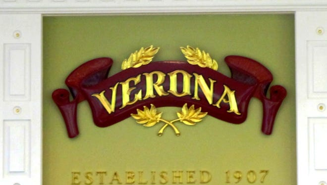 A new Verona sign hangs above the seat of the mayor in the Verona Township Council chambers at Town Hall on March 17, 2014.