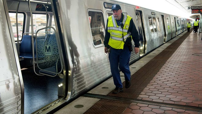 A Washington Metropolitan Area Transit Authority worker walks past a new 7000 series subway car on April 13, 2015. Metro is accepting delivery of 20 of the cars a month to replace aging trains.