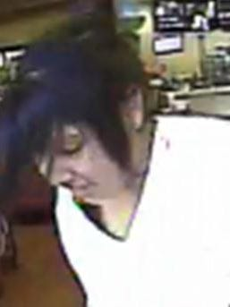 Female suspect caught on surveillance footage leaving the gas station.