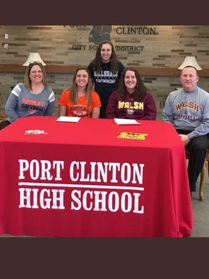 Port Clinton's Paige Steyer, middle left, and Lauren Steyer, middle right, announce plans to continue their softball careers at Findlay and Walsh, respectively. They are joined by mother, Heidi, siste, Taylor and father, Gary.