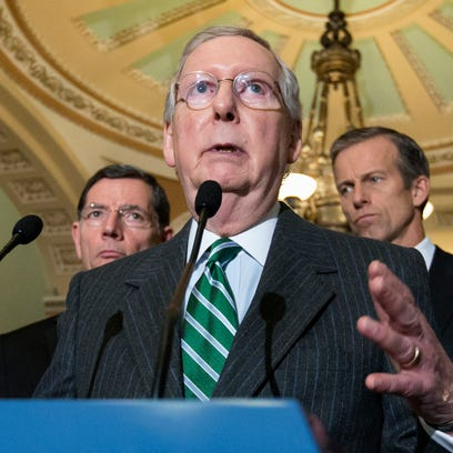 """In this Feb. 9, 2016 file photo, Senate Majority Leader Mitch McConnell of Ky. speaks on Capitol Hill in Washington. State and local governments would be permanently barred from taxing access to the Internet under a bipartisan compromise the Senate began pushing toward final congressional approval. McConnell said Thursday, Feb. 11, 2016,  the measure would relieve people of """"the worry that their Internet access is being taxed."""" (AP Photo/J. Scott Applewhite)"""