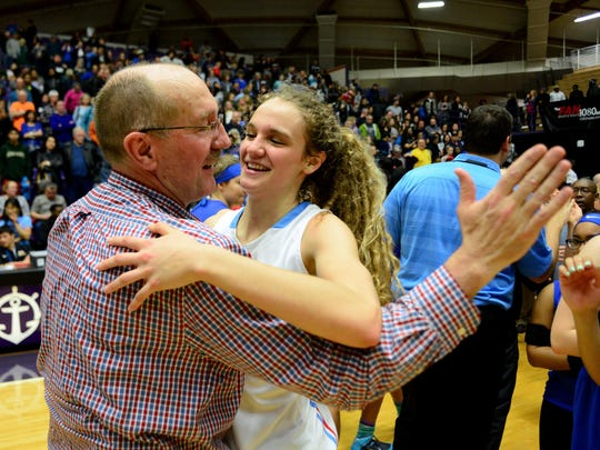 South Salem head coach Nick McWilliams and his daughter Katie McWilliams celebrate their state championship victory against St. Mary's after the OSAA class 6A basketball tournament inside the Chiles Center, on Saturday, March 14, 2015, at the University of Portland.