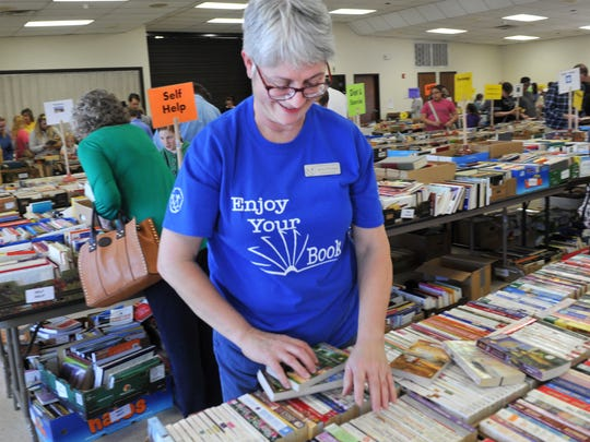 Wichita Adult Literacy Council's Betsy O'Connor works to organize books Friday morning during council's annual book sale at Midwestern State University's Sikes Lake Center. O'Connor said all proceeds from the sale go toward the adult literacy program.