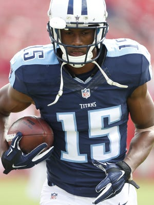 Tennessee Titans wide receiver Justin Hunter (15) warms up before an NFL football game against the Tampa Bay Buccaneers, Sunday, Sept. 13, 2015, in Tampa, Fla.