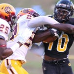 Grambling wide receiver Chad Williams (10) fights for yardage against Bethune-Cookman.