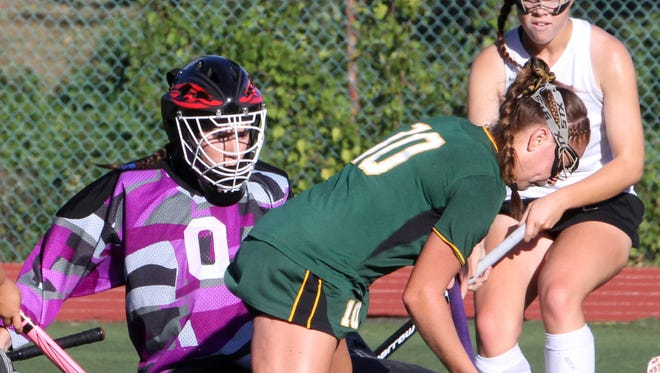 Lakeland's Meghan Fahey shoots on Rye goalie Maggie Devlin during a varsity field hockey game at Rye High School Sept. 15, 2016. Lakeland defeated Rye 3-1.