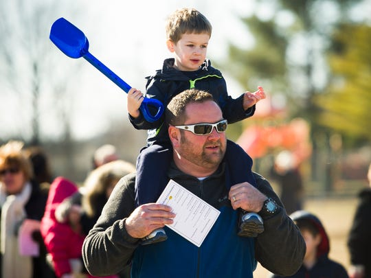 Brian Bobbitt, of McCutchanville, walks with his son, Lucas Bobbitt, 3, during a groundbreaking ceremony for the new McCutchanville Elementary, just north of McCutchanville Park on Petersburg Road, Saturday, Feb. 4, 2017. Lucas will attend the new school.