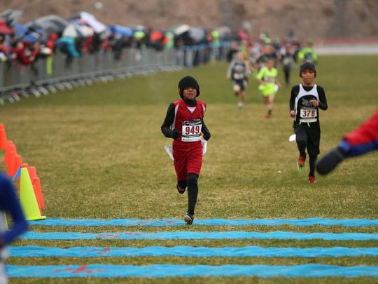 Ameen Ibrahim, who runs for the El Paso Flames, earned fifth place in the boys division, ages 7-8.