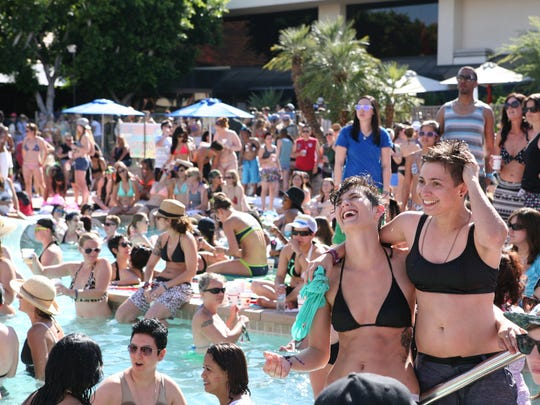 Hundreds of women gathered around the pool at the Hilton