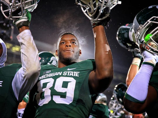 Michigan State Spartans defensive end Shilique Calhoun celebrates winning after a game against the Nebraska Corn Huskers at Spartan Stadium.