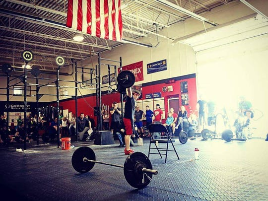 Zak Carchedi performs an exercise at CrossFit Sioux Falls, where he trained before moving to the Kansas City area.
