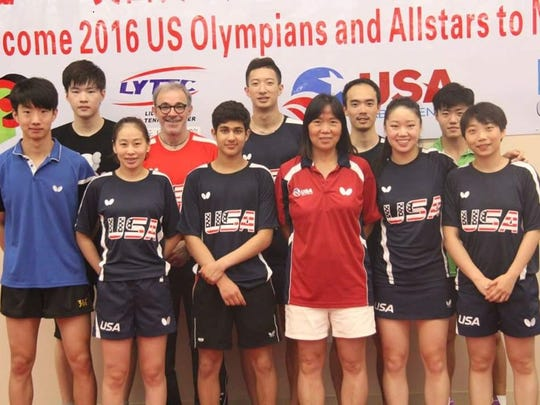 Dunellen-based Lily Yip, coach of the U.S. table tennis team, poses with her team.