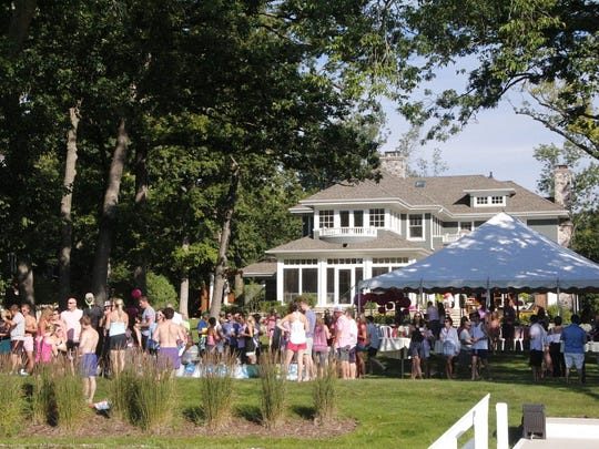 Mary and Daniel Druml hosted the Paddle for Pink fundraising event at their home on Oconomowoc Lake.