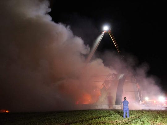 This fire at a hay storage barn on Jack Road the evening of Aug. 5 was still burning late in the afternoon on Aug. 6. Firefighters opted to let it burn rather than trucking in more water.