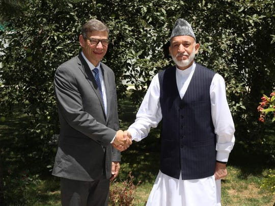 Ken Holland meets with Hamid Karzai, former president