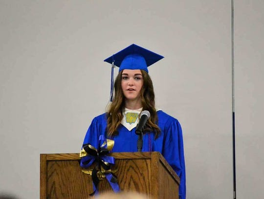 Mary Michels gives her valedictorian speech while graduating