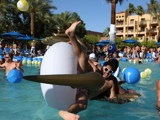 White Party Palm Springs revelers swim and dance during
