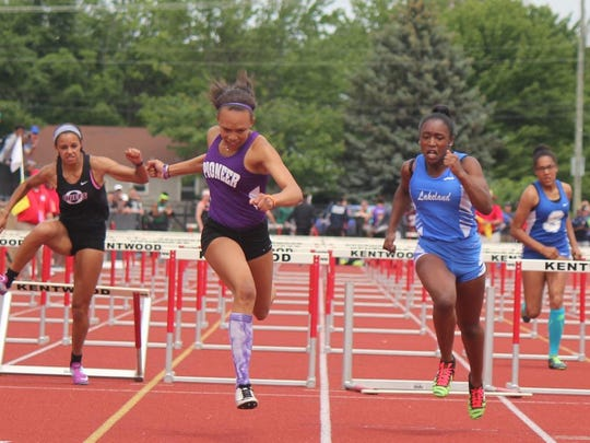 Ann Arbor Pioneer's Britten Bowen edges out White Lake Lakeland's Grace Stark at the finish of the 100-meter hurdles last year. Bowen's 13.40 and Stark's 13.62 were the two fastest times ever run at the Michigan state championships in 2017.