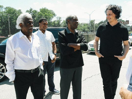 King Records drummer Philip Paul, and Otis Williams and Kent Butts talk with Jack White near a historical marker for the record label In Evanston.