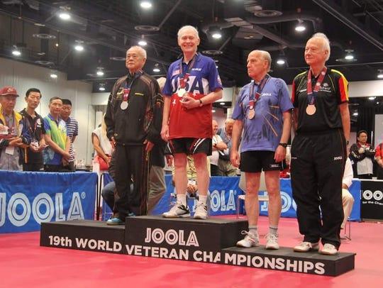 Richard Hicks atop the podium after winning the world
